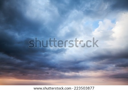 Dark blue stormy cloudy sky. Natural photo background - stock photo