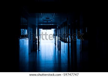 dark blue tone of long corridor in hospital. - stock photo