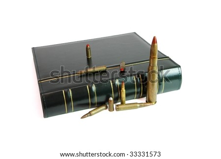 Dark book and cartridges of various calibers isolated - stock photo