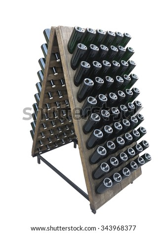 Dark bottles on a wine cellar wooden support isolated over white background - stock photo