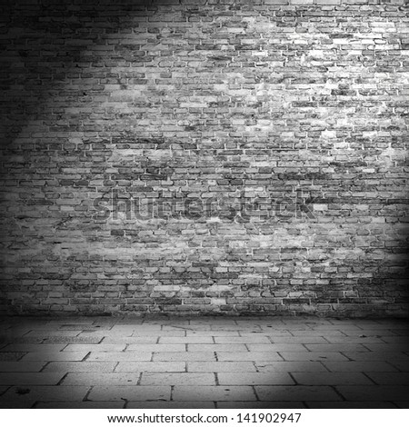 dark brick wall background in basement with beam of light - stock photo