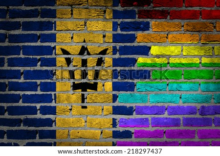 Dark brick wall texture - country flag and rainbow flag painted on wall - Barbados - stock photo