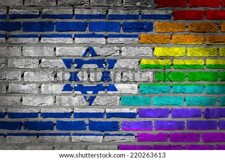 Dark brick wall texture - coutry flag and rainbow flag painted on wall - Israel - stock photo