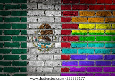 Dark brick wall texture - coutry flag and rainbow flag painted on wall - Mexico - stock photo