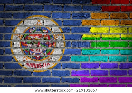 Dark brick wall texture - coutry flag and rainbow flag painted on wall - Minnesota - stock photo