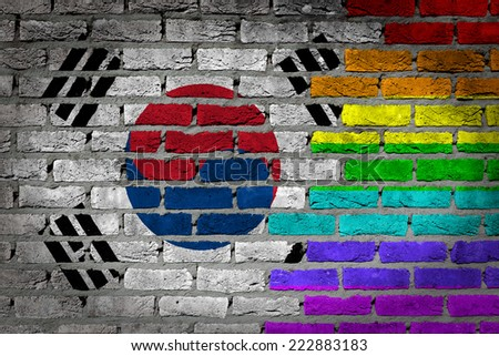 Dark brick wall texture - coutry flag and rainbow flag painted on wall - South Korea - stock photo