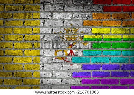 Dark brick wall texture - coutry flag and rainbow flag painted on wall - Vatican - stock photo