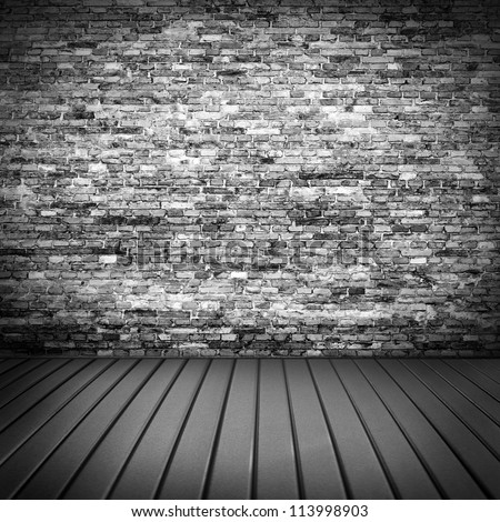 dark brick wall texture in basement house interior with beam of light and wooden floor, may use as grunge halloween background or night club advertising - stock photo