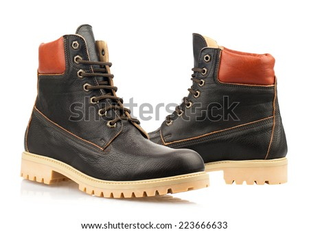 Dark brown boots with shoelace on white background.  - stock photo