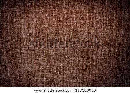 Dark brown canvas texture background, dark edged - stock photo