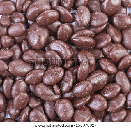 Dark brown dragee in chocolate covered. Whole background. - stock photo