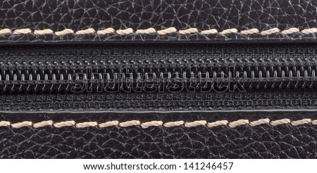 Dark brown leather texture and zipper background - stock photo