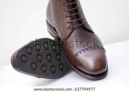 dark brown scotch grain leather boots - stock photo