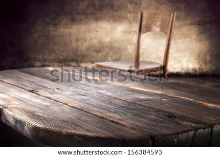 dark brown table and worn old wall  - stock photo