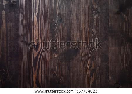 Dark brown wooden plank background, vintage and retro - stock photo