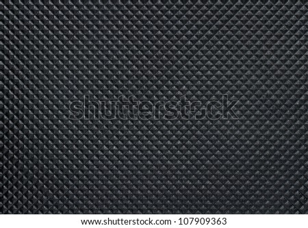 Dark bumpy plastic texture with copy space - stock photo