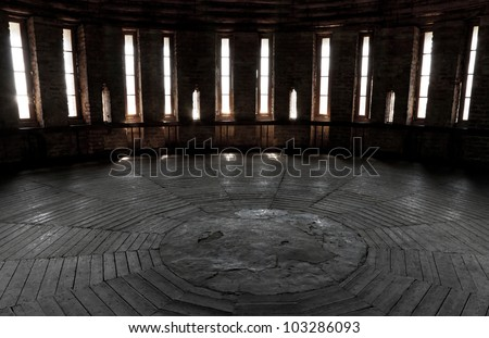 Dark castle tower round room interior with glowing windows. Ancient fortress (Kremlin) in Smolensk town, Russia - stock photo