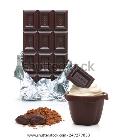 Dark chocolate bar in foil, cupcake, cacao beans and powder  isolated on white background - stock photo
