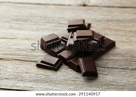 Dark chocolate bar on grey wooden background - stock photo