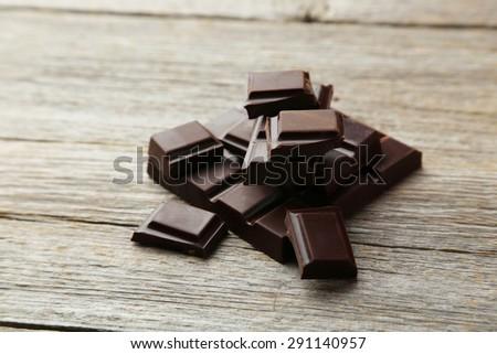 Dark chocolate bar on grey wooden background - stock photo