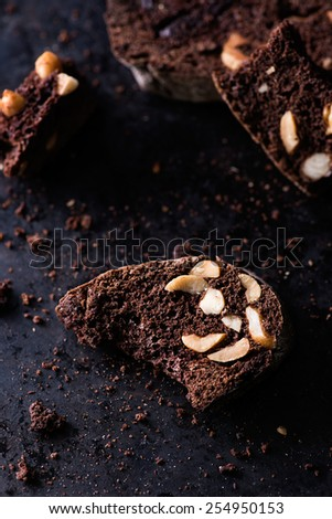 Dark chocolate biscotti with nuts, selective focus - stock photo