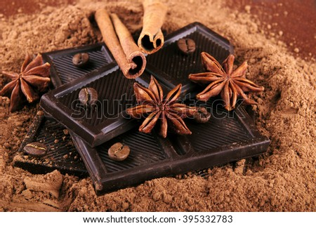 Dark chocolate, cocoa, anise stars and cinnamon sticks. The composition of chocolate and the ingredients. - stock photo