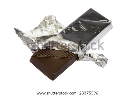 Dark chocolate on a foil on a white background is isolated clipping path - stock photo