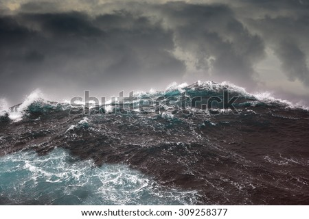 Dark clouds and crashing ocean waves during storm in the atlantic ocean - stock photo