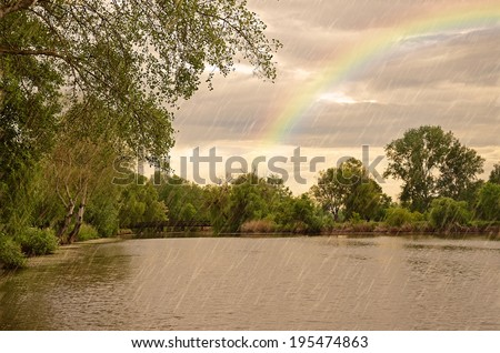Dark clouds and rain storm over the lake, detail - stock photo