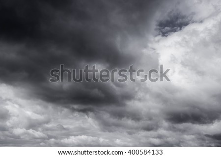 Dark clouds before a thunder-storm - stock photo