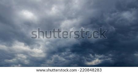 Dark clouds before thunderstorm - stock photo