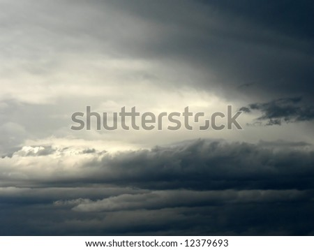 Dark clouds gathering for an impending storm. - stock photo