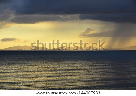 Dark clouds on the lake - stock photo