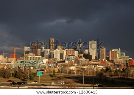 Dark clouds over Denver skyline - stock photo