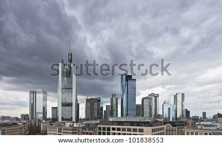 Dark clouds over the financial centre in Frankfurt, Germany. Most of the buildings in this region are the headquarters of businesses and corporations - stock photo