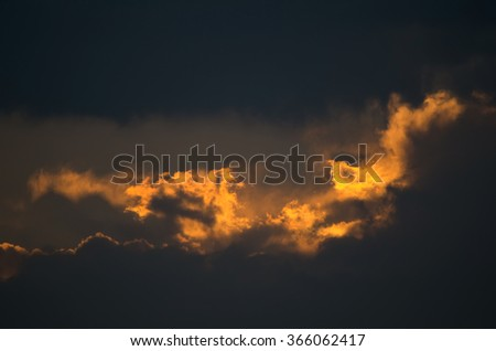 Dark Cloudscape Closeup at Sunset with Flames - stock photo