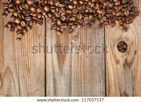 dark coffee on the wooden table background - stock photo