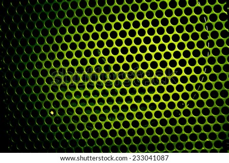 dark color metal pattern with holes - stock photo