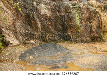 dark copper mine tunnel with anthracite samples - stock photo