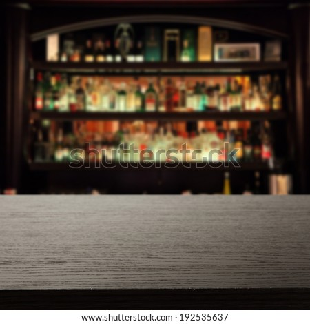 dark desk of free space and bar  - stock photo