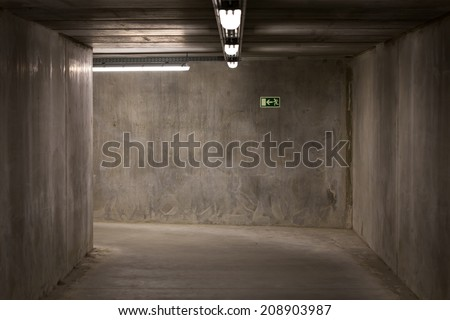 Dark empty underground passage tunnel made from concrete - stock photo