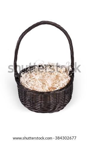 Dark empty wicker basket with hay inside - path included - stock photo