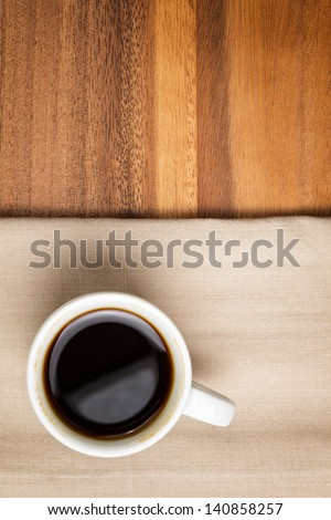 dark espresso in a cup on table, background for cafe - stock photo