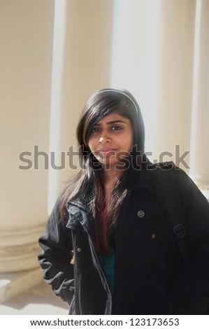 Dark ethnic college student in the campus. - stock photo