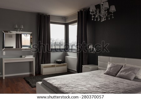 Dark expensive bedroom with black and grey walls - stock photo