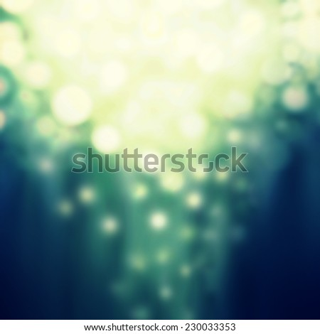 Dark Festive Christmas background. Abstract twinkled night background with bokeh defocused golden lights. Holiday party background with blurry boke special magic effect. - stock photo