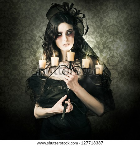 Dark Fine Art Grunge Photo Of A Beautiful Woman Walking The Halls Of Haunted Horror In Vintage Vouge Fashion - stock photo