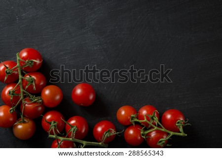 Dark Food Background Tomatoes - stock photo
