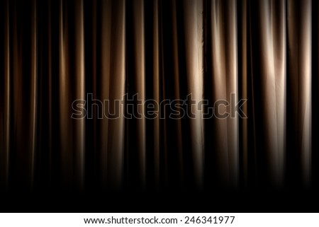 Dark gold curtain fade to black - stock photo