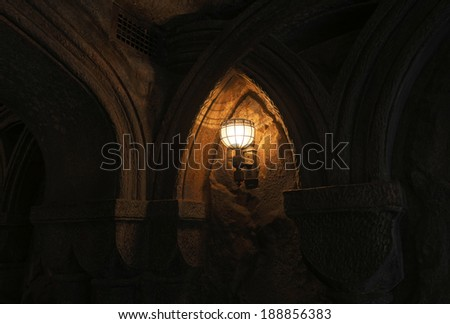 Dark Gothic dungeon with lantern - stock photo